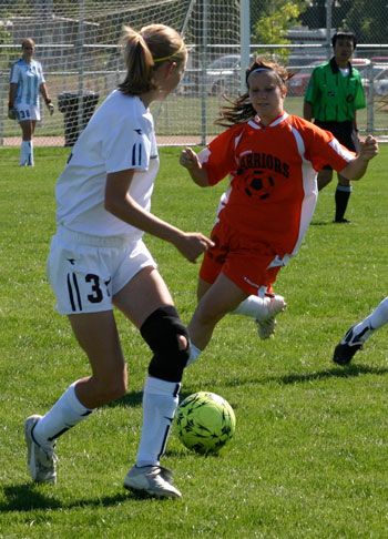 Sports Girl Wears Knee Brace While Playing Soccer